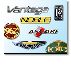 Various car badges in vitreous enamel
