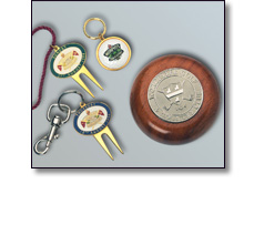 Various corporate Gifts such as Paper weights, golf pitch repairers
