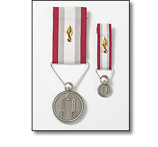 Military medal on a short ribbon, and miniature