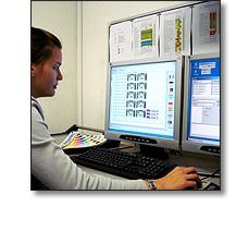 Operatior setting up a name badge job. Fattorini