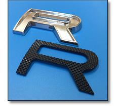 Automotive badge lettering